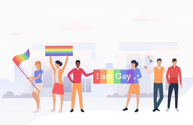 Mensen die lgbtq-vlaggen houden en ik ben een homobanner in een parade