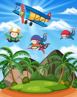 Mensen die over mooi landschap parachutespringen