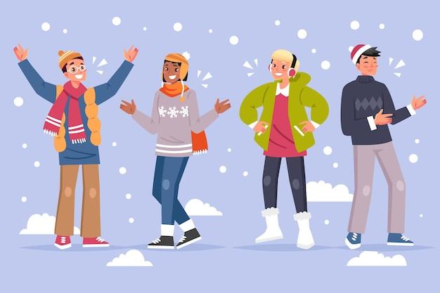 Mensen dragen winterkleren en staan in de sneeuw