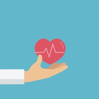 Mensen hand geeft een rood hart, bloeddonatie, wereld bloeddonordag