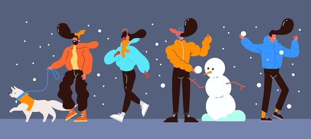Mensen hebben plezier in de wintersneeuw Gratis Vector