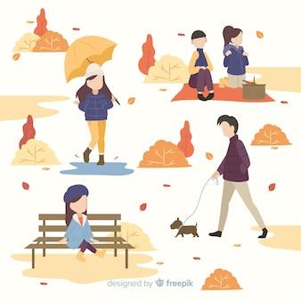 Mensen in het park in de herfst