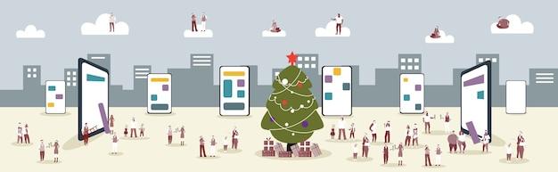 Mensen in santa hoeden met behulp van online mobiele applicatie mannen vrouwen met corporate party kerstmis nieuwjaar vakantie concept smartphone stadsgezicht schermachtergrond