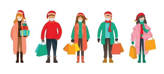 Mensen in winterkleren dragen gezichtsmasker, kerstinkopen concept