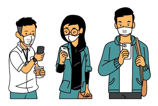 Mensen kijken naar hun telefoon terwijl het dragen van een masker