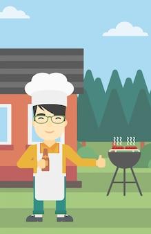 Mensen kokend vlees bij de grill van de gasbarbecue.