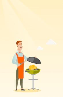 Mensen kokende kip bij de barbecuegrill.