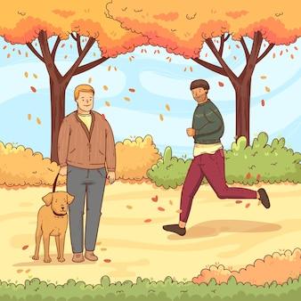 Mensen lopen in de herfst met hond