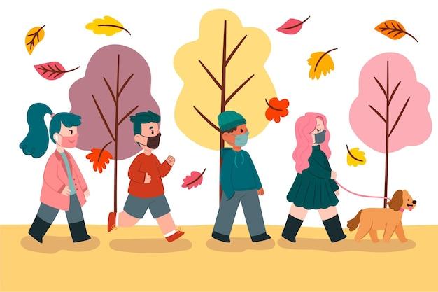 Mensen lopen in de herfst