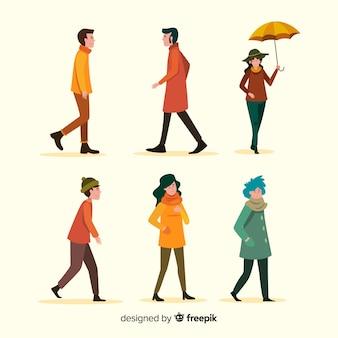 Mensen lopen in herfst plat ontwerp