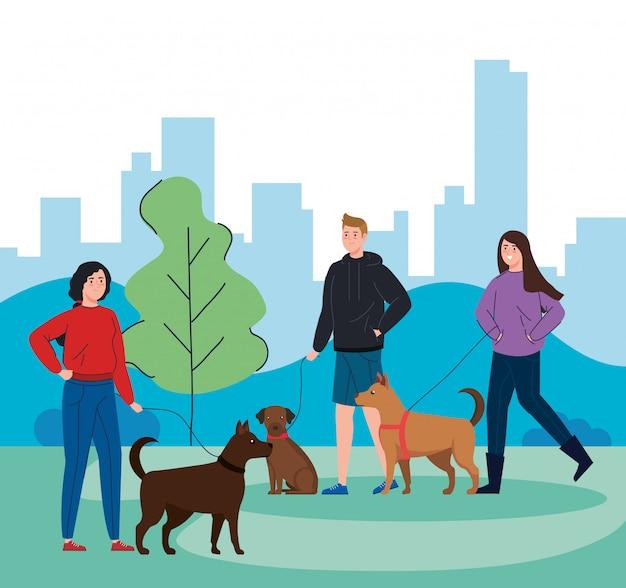 Mensen lopen met honden in landschap