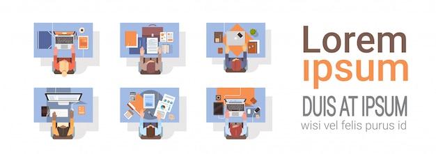 Mensen met behulp van computers ondernemers werkplek bureau bovenhoek view laptop desktop teamwork