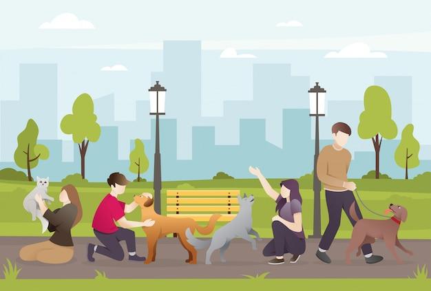 Mensen met hun huisdieren in het park