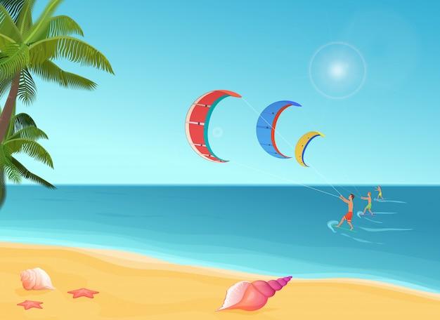 Mensen met parachutes kiteboarding in zee.