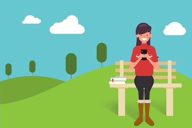Mensen mobiel chatten in het park.