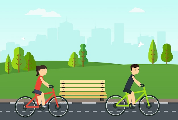 Mensen op fietsen rijden in het stadspark.