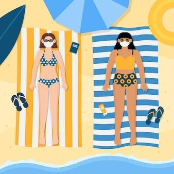 Mensen op het strand die het thema van gezichtsmaskers dragen