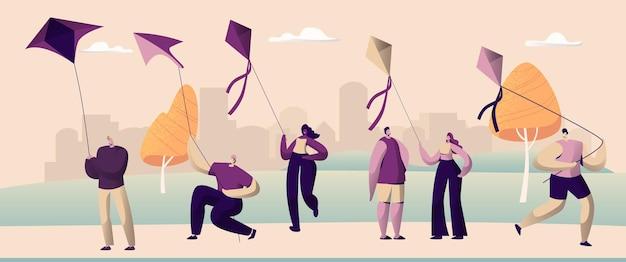 Mensen spelen met air kite outdoor spring park. h.