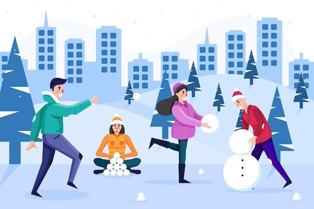 Mensen spelen met sneeuw