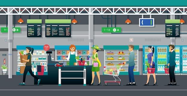 Mensen staan in de rij om goederen in supermarkten te betalen