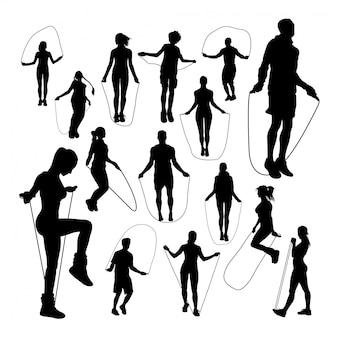 Mensen touwtjespringen silhouetten