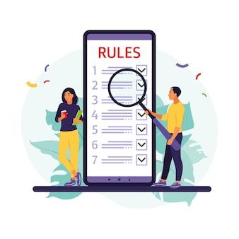 Mensen uit het bedrijfsleven bestuderen lijst met regels, begeleiding lezen, checklist maken.