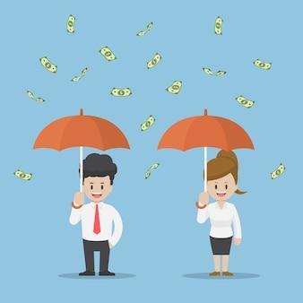 Mensen uit het bedrijfsleven houden paraplu en staan onder de regen van geld, zakelijk succes en rijkdom concept