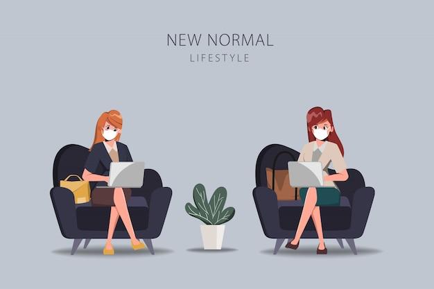 Mensen uit het kantoor houden sociale afstand en dragen een gezichtsmasker nieuwe normale levensstijl.