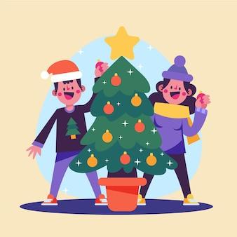 Mensen versieren de kerstboom