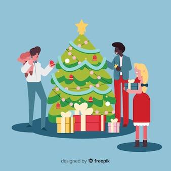 Mensen versieren kerstboom pack
