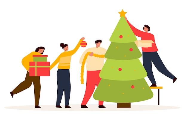 Mensen versieren kerstboom samen