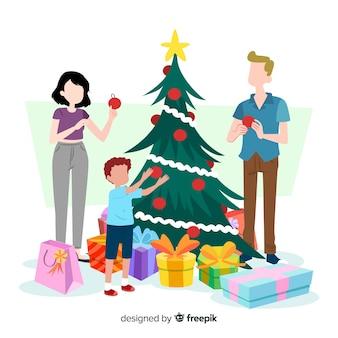 Mensen versieren kerstboom