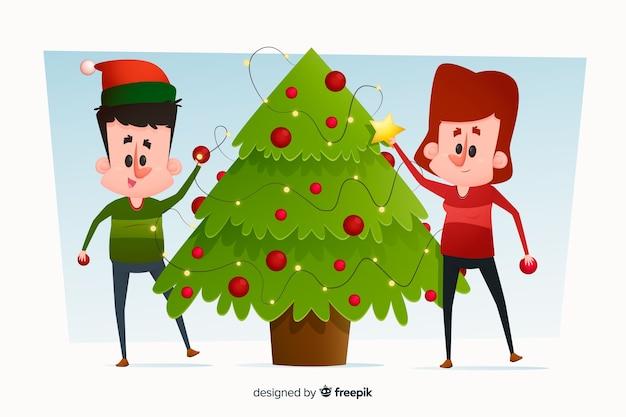 Mensen versieren samen kerstboom