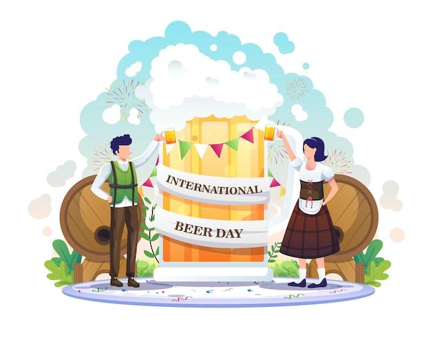 Mensen vieren internationale bierdag met een gigantische bierillustratie