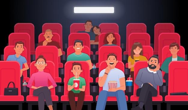 Mensen zitten in stoelen en kijken naar een film in de bioscoopzaal eten drinken drinken film kijken