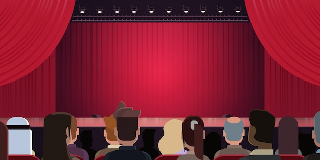 Mensen zitten in theater of in bioscoop kijken fase met rode gordijnen wachten op prestatie st
