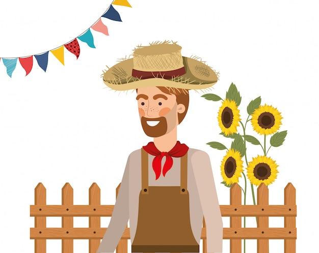 Mensenlandbouwer met strohoed en zonnebloemen