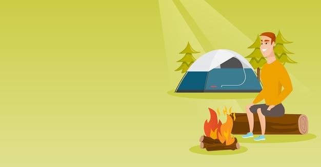 Mensenzitting op logboek dichtbij kampvuur in de camping.