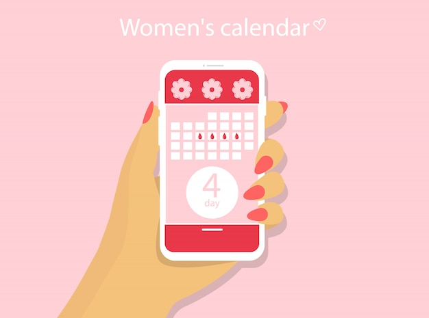 Menstruele kalender. aanvraag voor een telefoon met een vrouwelijke kalender. een hand houdt een telefoon vast.