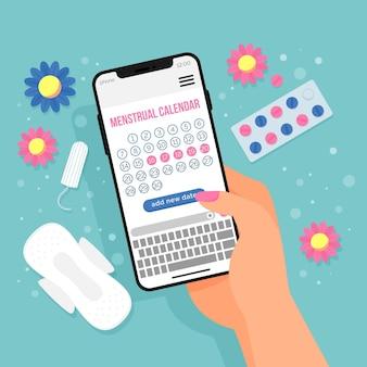 Menstruele kalenderconcept met telefoon