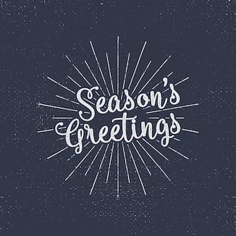 Merry christmas belettering. de groeten van het seizoen. vakantie typografie vector. brievensamenstelling met zonuitbarstingen en halftone textuur.