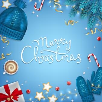 Merry christmas belettering groet achtergrond winter elementen fir takken geschenken hoed wanten garland