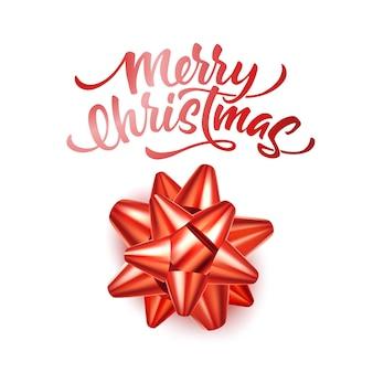 Merry christmas belettering met realistische rode strik
