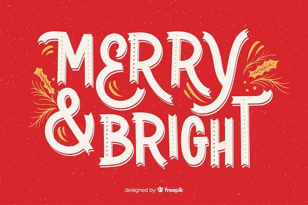 Merry christmas belettering op rode achtergrond
