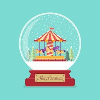 Merry christmas glazen bol met kerk in winterseizoen.