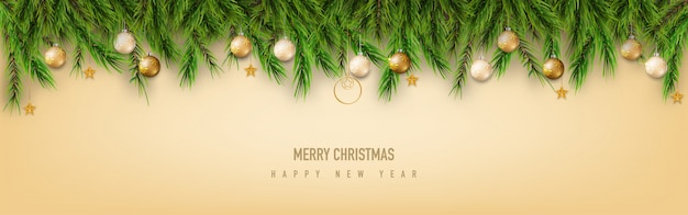 Merry christmas greeting met pijnboomtakken en xmas bal