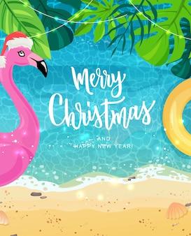 Merry christmas hand belettering voor exotische nieuwjaarsviering. roze flamingo, tropische bladeren.