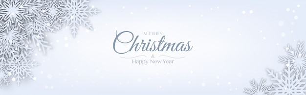 Merry christmas horizontale banner decoratief ontwerp met witte origami papier gesneden sneeuwvlok Premium Vector