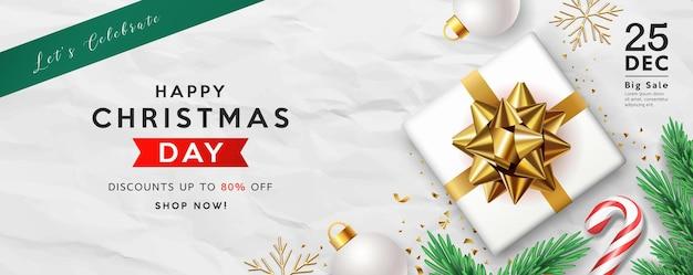 Merry christmas sale geschenkdoos gouden boog lint dennenbladeren snoepgoed witte bal wenskaart