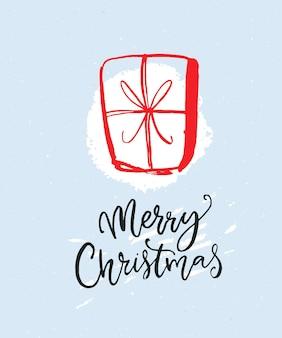 Merry christmas wenskaart met hand getrokken cadeau en kalligrafie inscriptie.